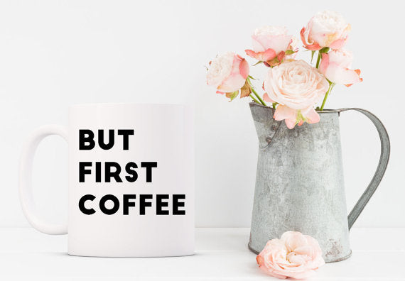 white ceramic mug coffee tea black font but first coffee watering can flowers