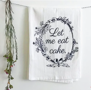 funny kitchen towel tea towel let me eat cake folded over line hanging with flowers