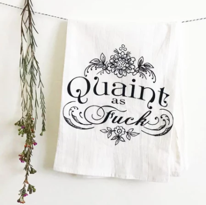 funny kitchen towel tea towel quaint as fuck AF folded over line hanging with flowers