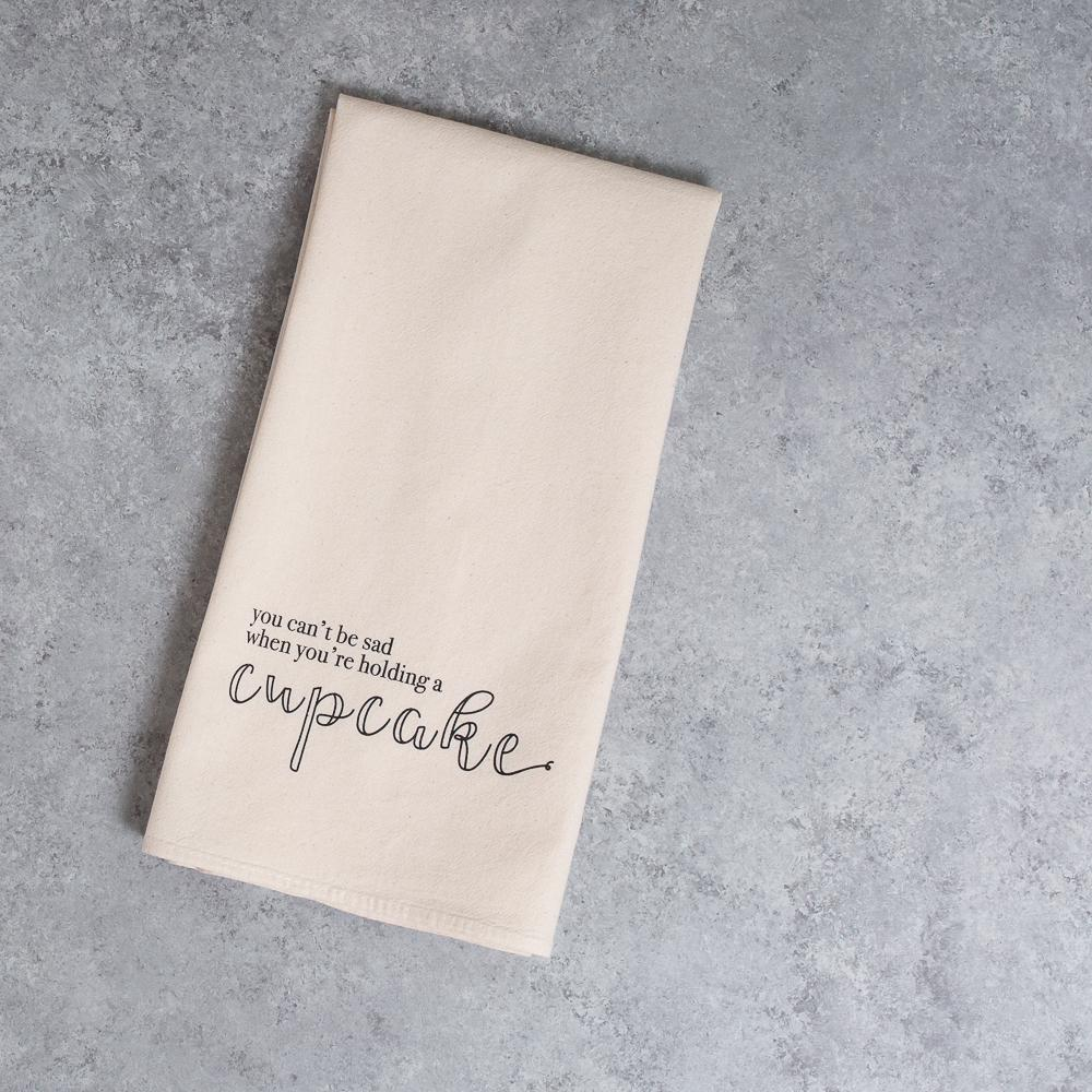 cant be sad when youre holding a cupcake unbleached cotton kitchen tea towel funny towel