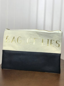 canvas and faux leather makeup bag gold zipper gold foil font bag of lies