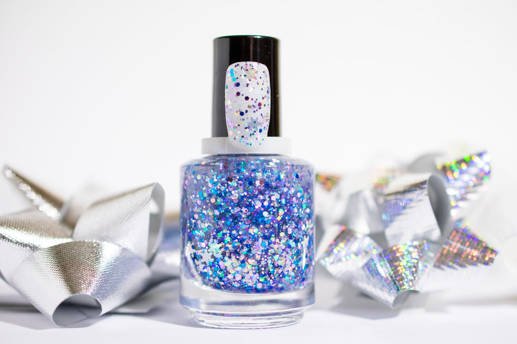 Pretty little metallic blue, violet, silver and aqua glitters and holographic silver snowflake shape glitters galore cruelty free vegan toxin free handmade manicure pedicure