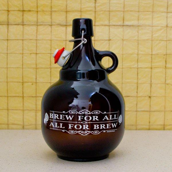 The Brew For All 2 liter Palla Growler on a table in front of an inch-graduated grid