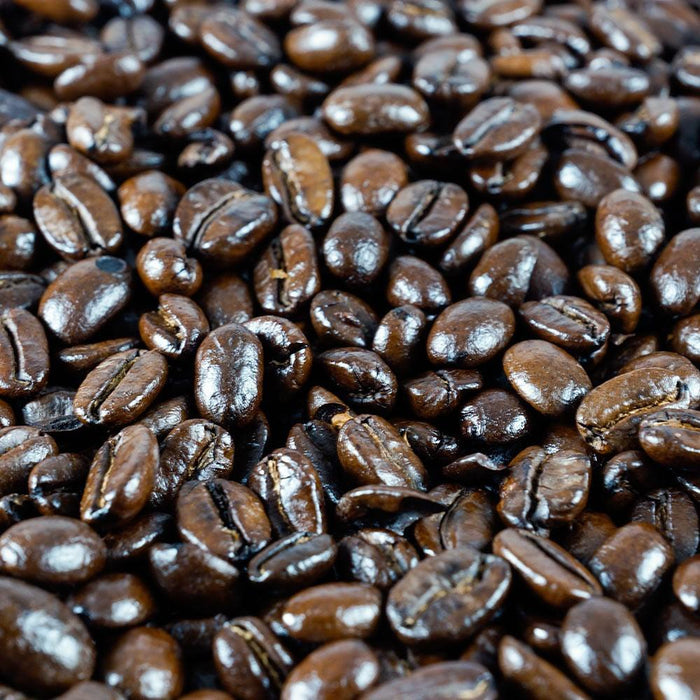 Detail view of Peace Coffee's french roast style whole coffee beans