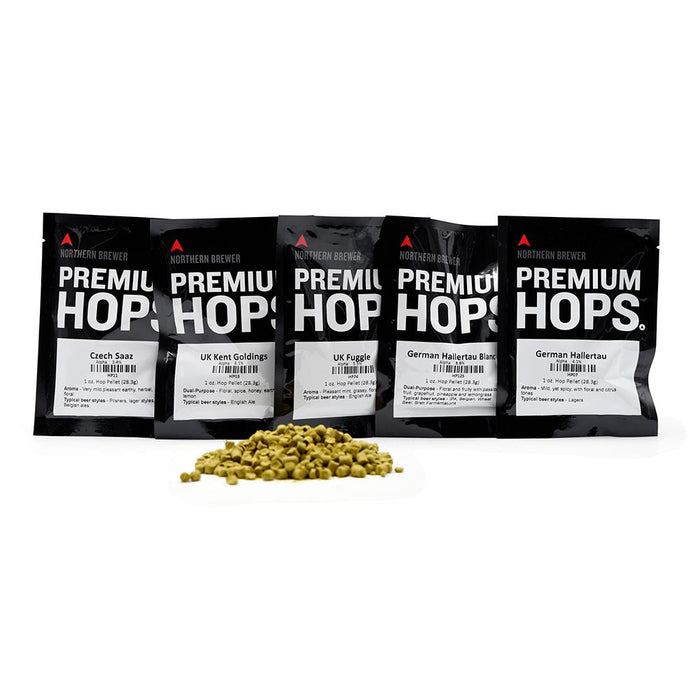 All five bags included in the European Noble Type Sampler Pack alongside a small pile of hop pellets