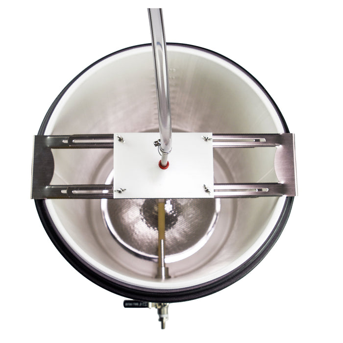 Top-down view into the mash tun, showing off the sparge arm with tubing connected