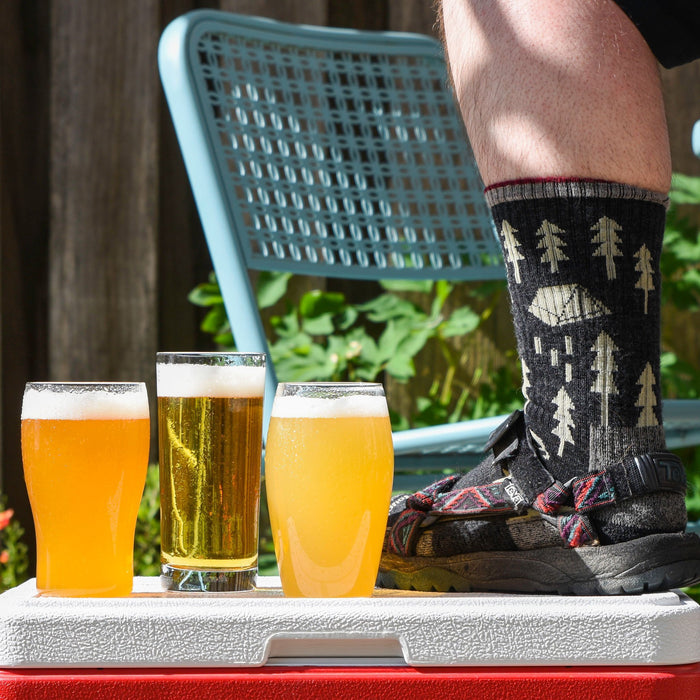 Socks & Sandals Summer Extract Beer Variety Pack with Patricks Foot wearing socks and sandals on a cooler