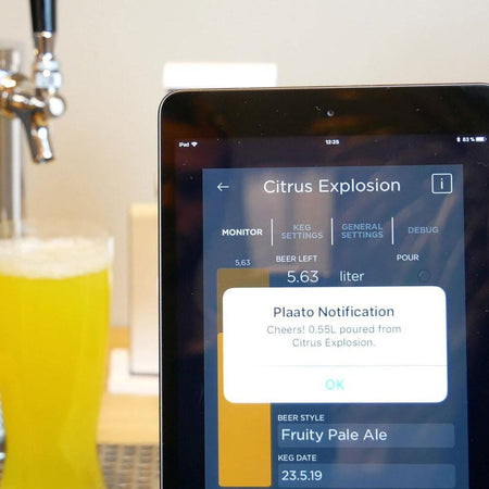 Displaying a pour notification on PLAATO app with beer faucet and full beer glass in background.