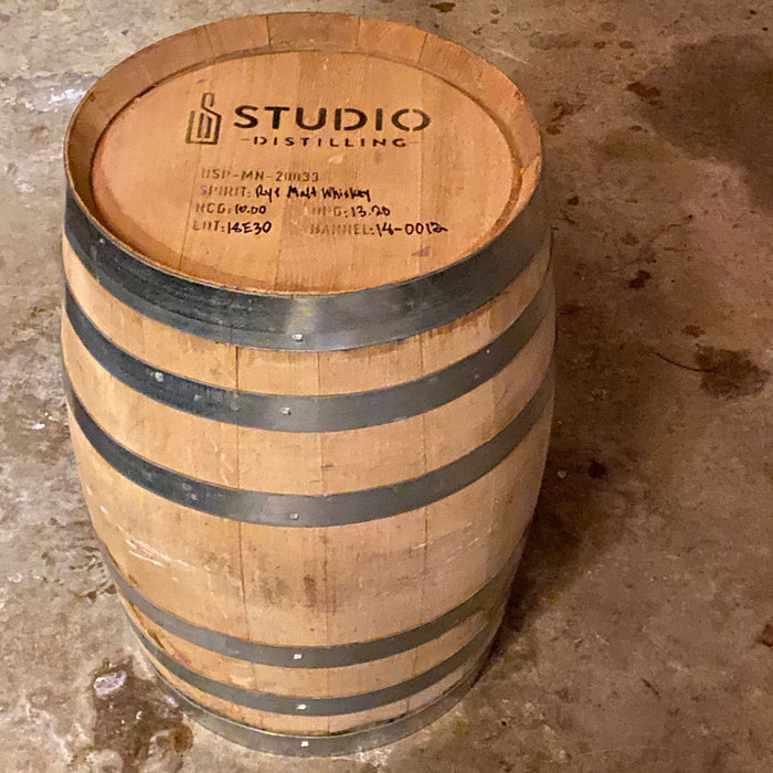Studio Distilling Barrel on the end showing head with distillery info
