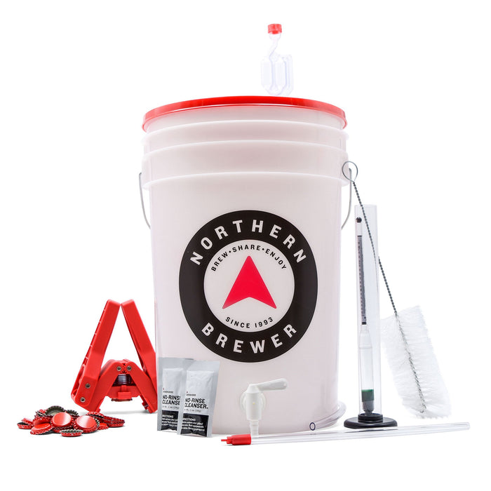 Hard Cider Making Kit which includes the siphonless bucket, bottle brush, test jar, hydrometer, bottle capper, bottle caps, and air lock