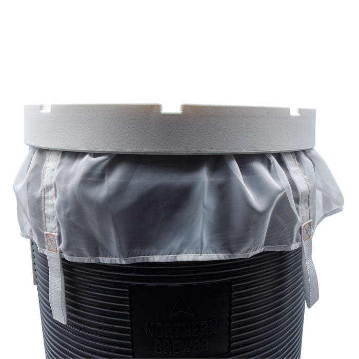 The reusable Brew Bag set in a mash tun with lid on