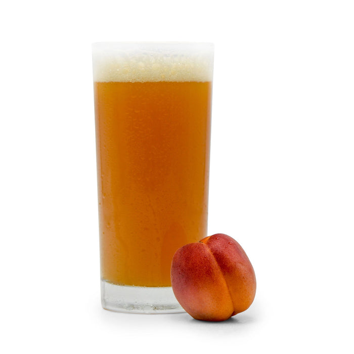 Apricot next to Fruit Stand Wheat Beer in a glass