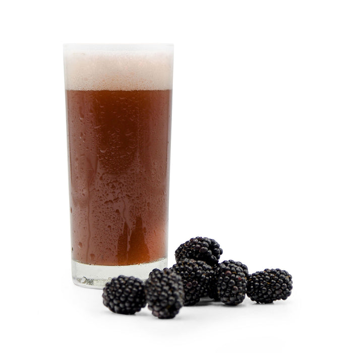 Pile of Blackberries next to a glass of Fruit Stand Wheat Beer