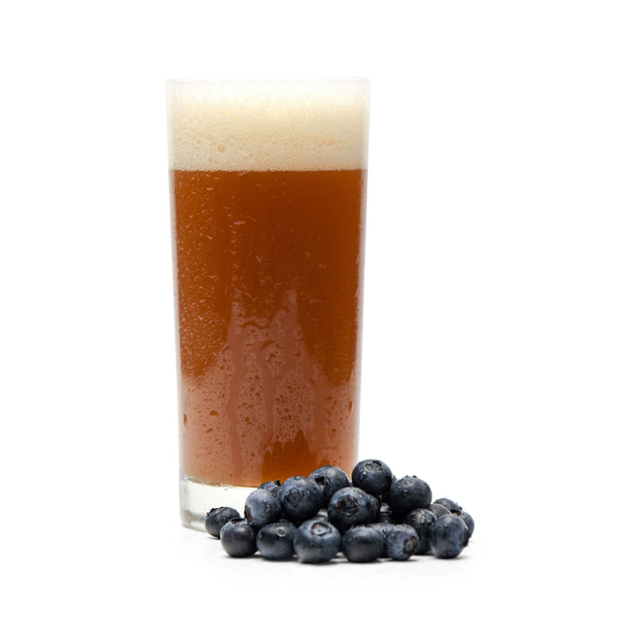 Blueberries next to Fruit Stand Wheat homebrew in a glass