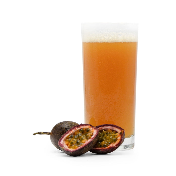 Sliced Passion Fruit beside Fruit Stand Wheat Beer in a glass