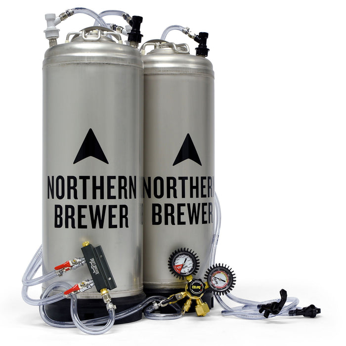Two 5-gallon corny kegs attached to a two-way co2 distributing manifold and a co2po dual-gauge co2 regulator with gas tubing