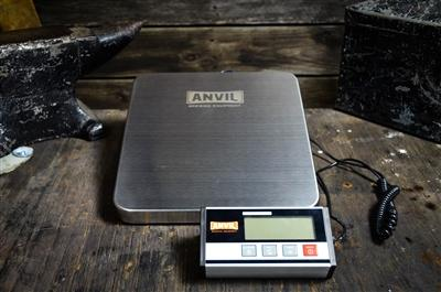 The large Anvil Brewing Scale on a table with a real anvil in the background