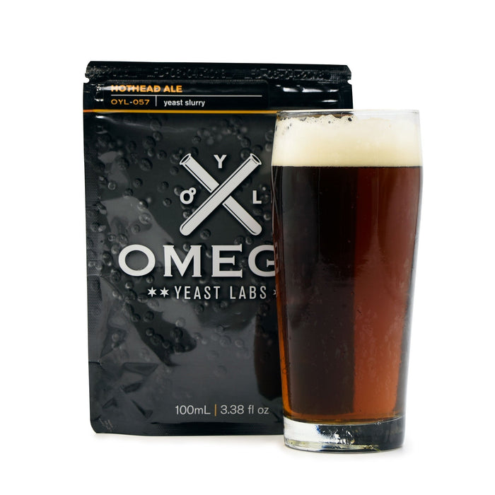 Irish Red Ale homebrew in a glass in front of a pouch of an Omega yeast pouch