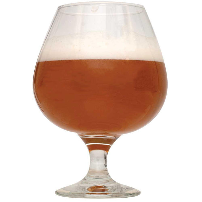 Shugga High Barleywine in a half-filled glass