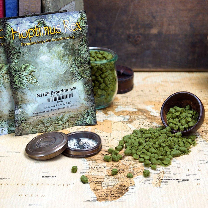 N1/69 Experimental Hop Pellets spilt onto a map of Africa, beside its packaging and a compass