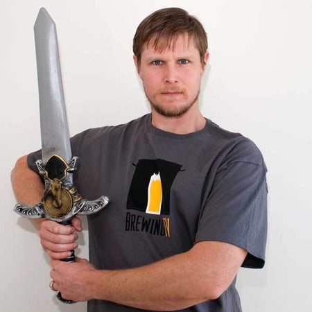 A cool homebrewer brandishing a fancy sword wearing the Brewing TV shirt