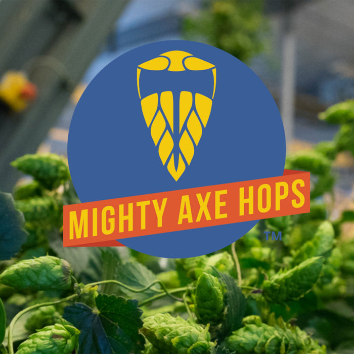 Mighty Axe Hops logo in front of a hops plant