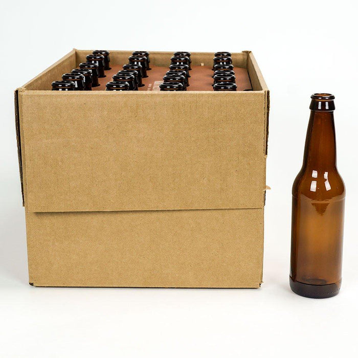 An open box of 24 beer bottles, and a brown glass bottle standing next to it.