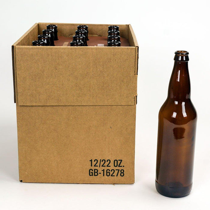 A 22 ounce brown beer bottle standing next to a 12 pack of beer bottles.