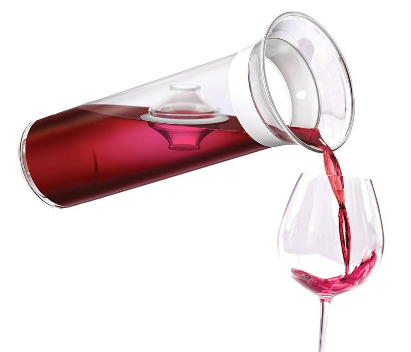 The Savino Carafe pouring wine into a wine glass