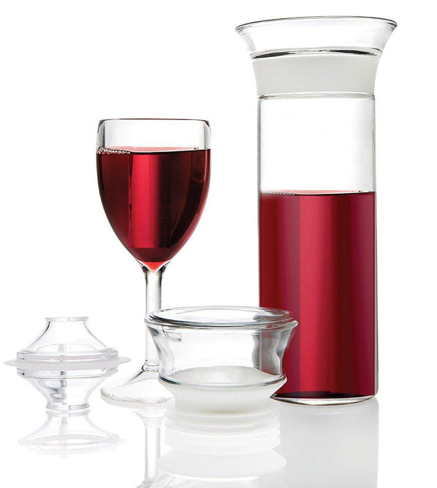 The Savino Connoisseur Glass Wine Preservation Carafe, disassembled, filled with wine, beside a wine-filled glass