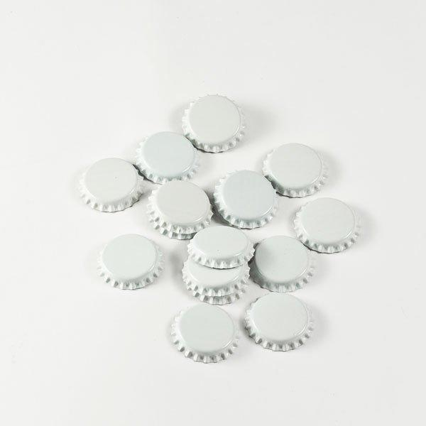 Small pile of white Crown Beer Bottle Caps