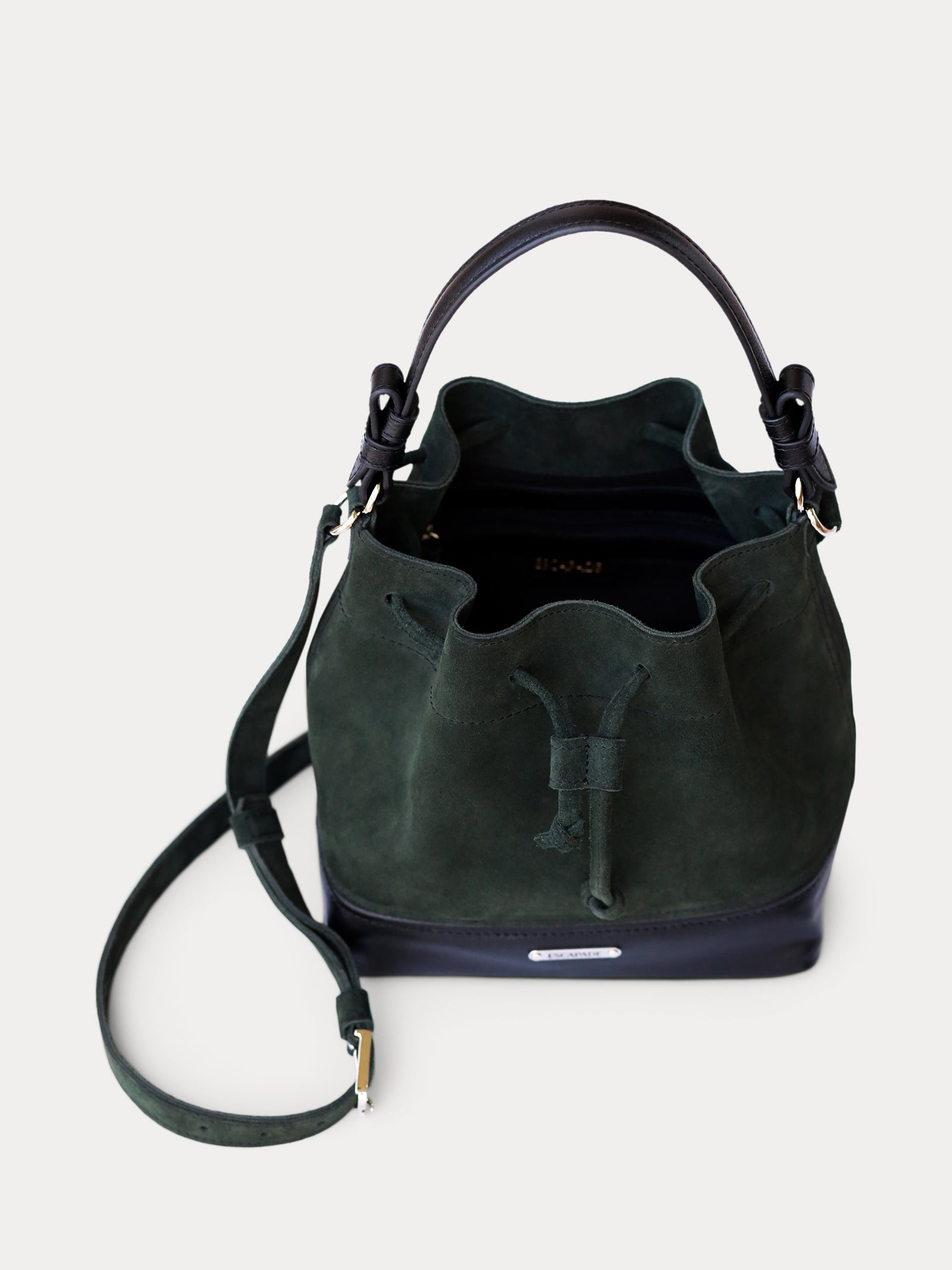 handcrafted green suede bucket bag