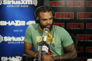 Jidenna on Sway in the morning wearing a Jamhuri Wear Kinyozi t-shirt