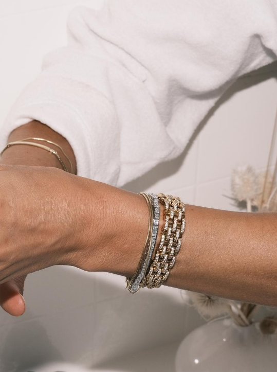We wear this 1930's inspired intricate chain bracelet with jeans and tees, blazers, and she's on regular rotation with our sweatshirts, which is what we're wearing on the daily right now. Benadetta is gold-plated with pave diamonds and finished with a fold-over clasp - so you're not going to lose her.