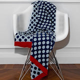 Woven knitted throw hundred percent cotton reversible red border light blue dark blue polka dot throw Pinata Kids Australia New Zealand
