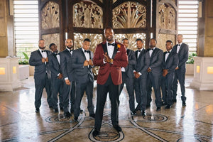 Group of groomsmen and groom in tuxedos