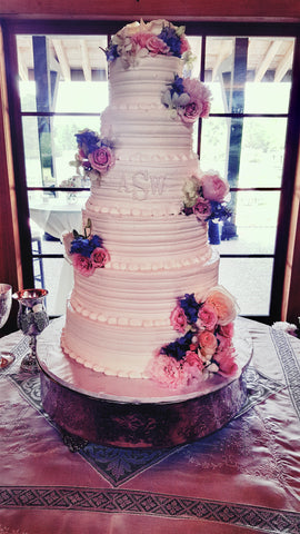 6 tiered wedding cake with fresh flowers