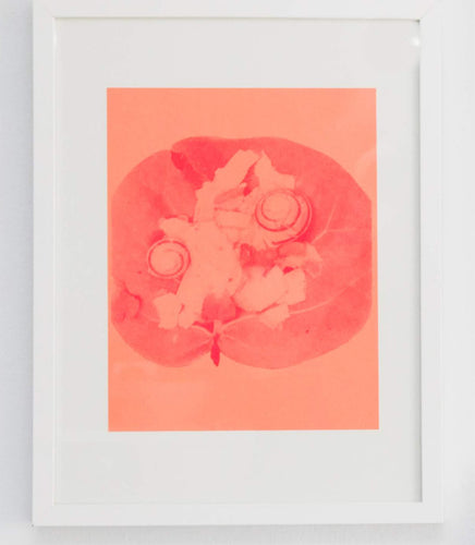 Fluorescent Pink Risograph print of a leaf on orange paper made by Juana Meneses / Loteria Press