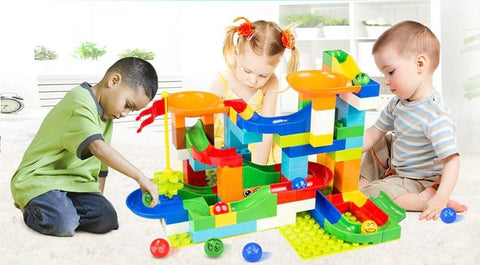 Three Kids playing with Marble Race Run Maze Balls Track Building Blocks-Puzzle Toys