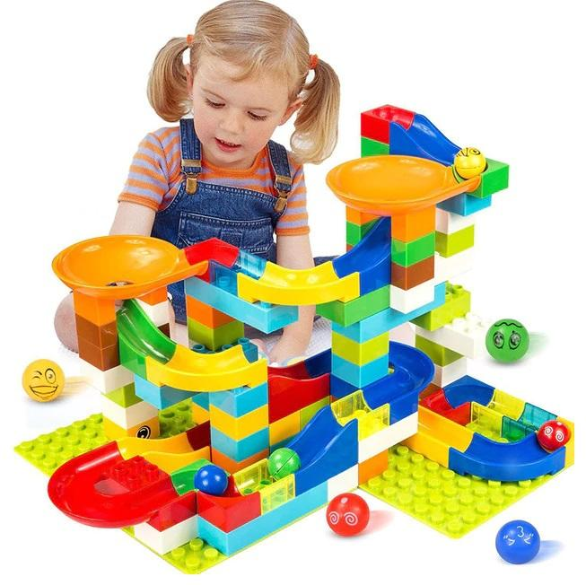 Kid playing with Marble Race Run Maze Balls Track Building Blocks-Puzzle Toys
