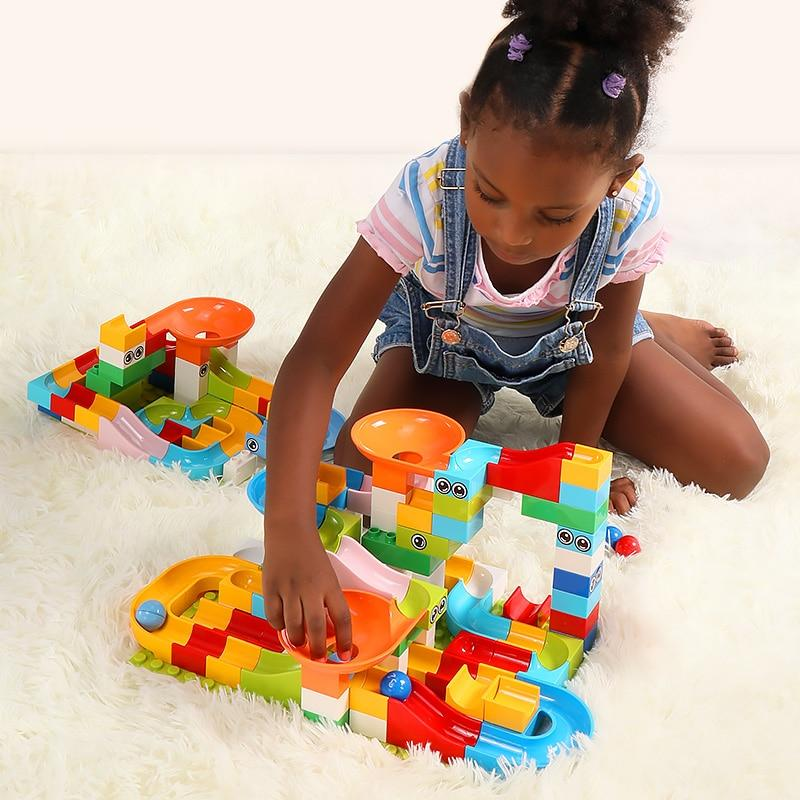 Preschool playing with Marble Race Run Maze Balls Track Building Blocks-Puzzle Toys