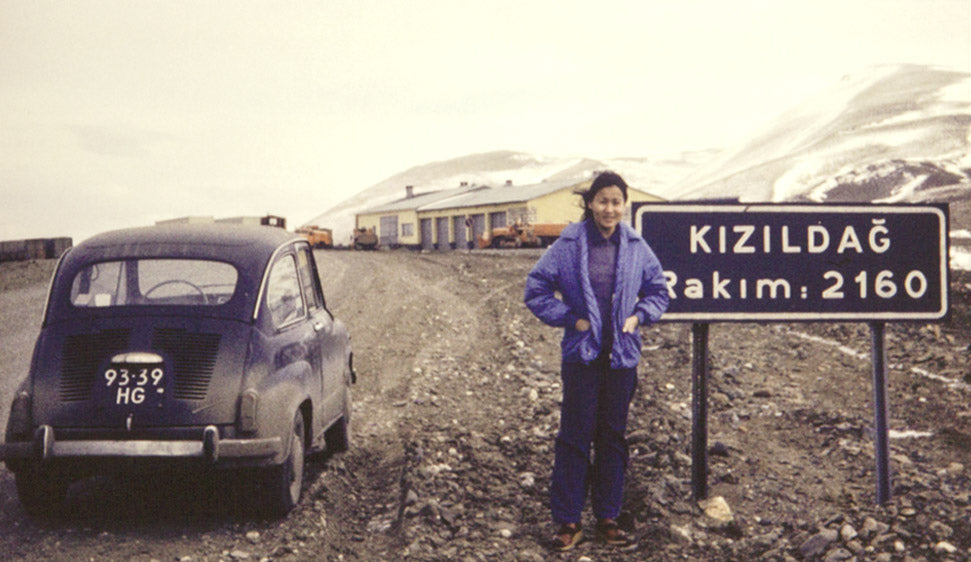 Chau with a Fiat by a roadsign