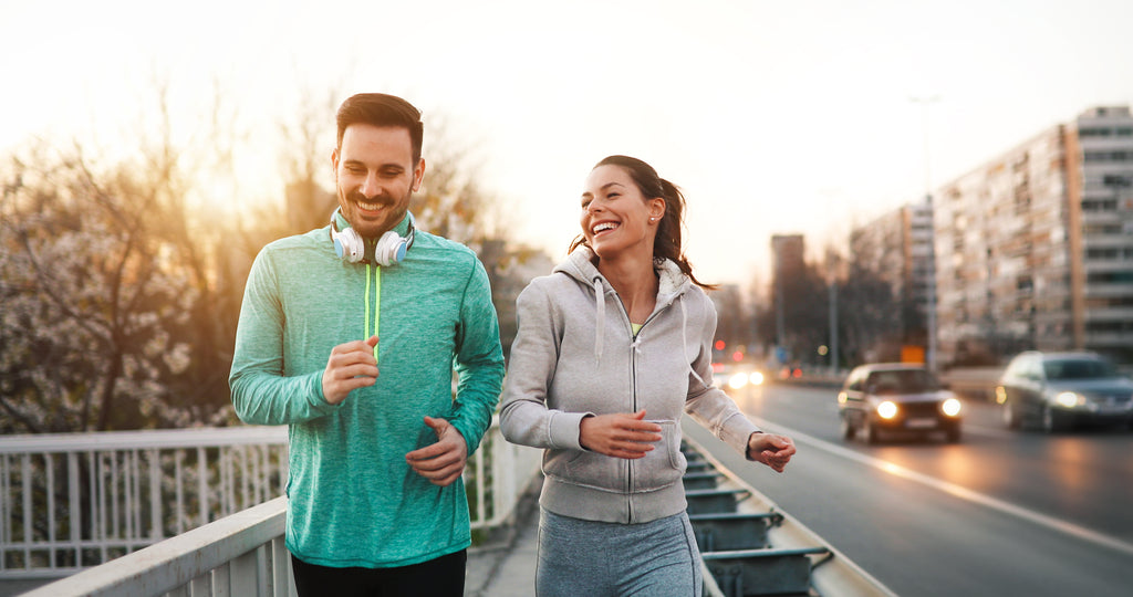 couple making smart goals working out jogging outside