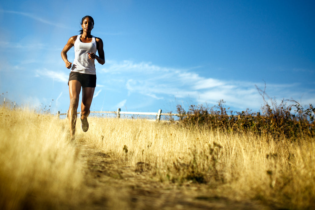 woman running in field - joint pain - turmeric - aceva mobility