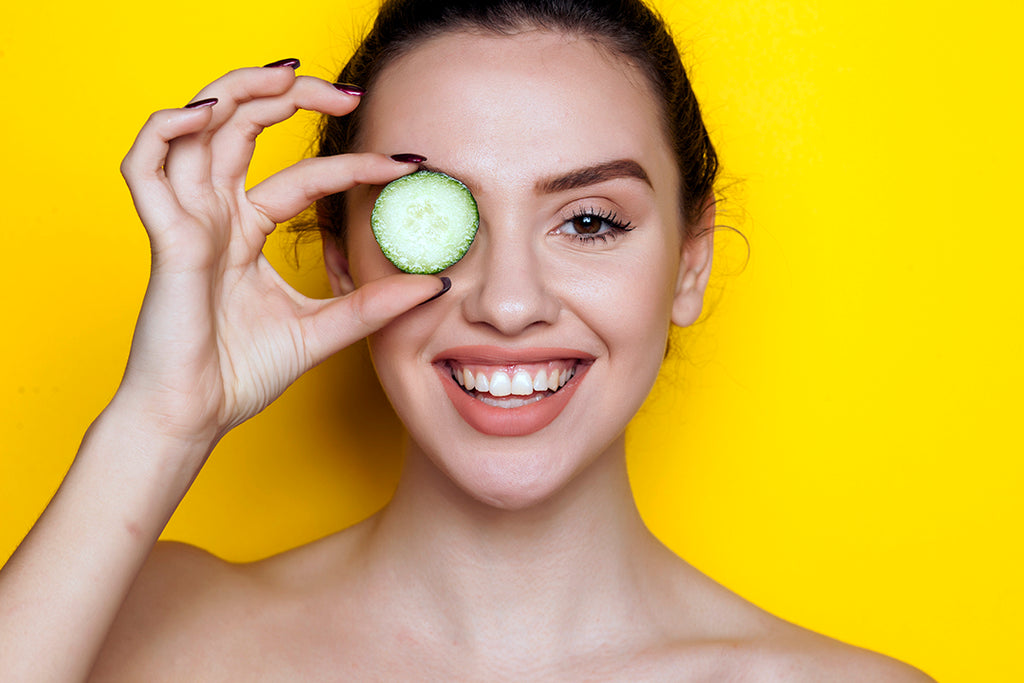 Woman holding cucumber slide to eyes - Allergy Relief - Itchy Eyes