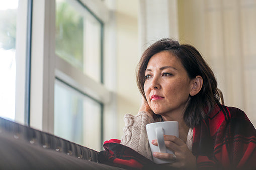 omega 3 and depression - woman looking out window