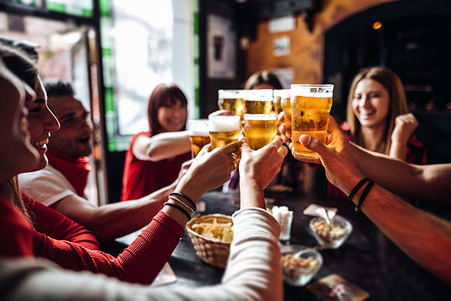 group of friend drinking beer - changing behaviors for heart health - aceva heart care bundle