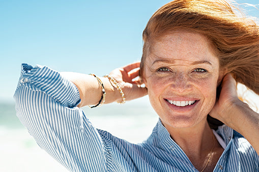 redheaded woman out in the sun - omega 3 and skin health