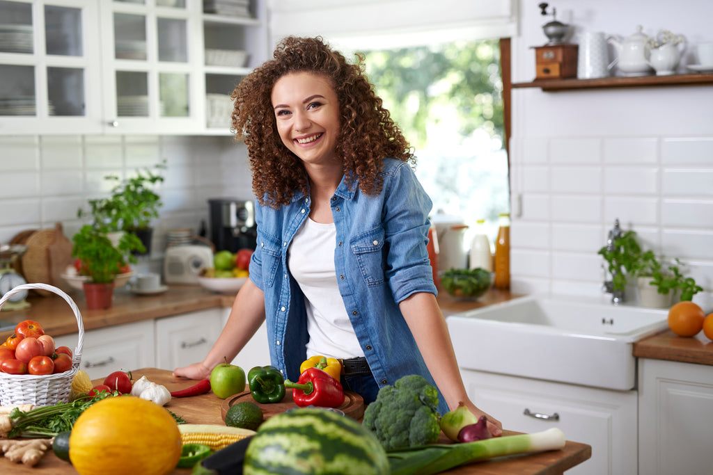 woman prepping food in kitchen - nutrition - nutrient pairings