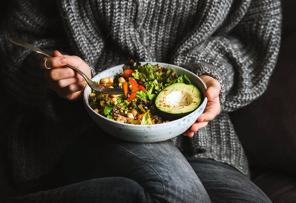 woman eating fresh salad - avocado beans and vegetables - nutrients